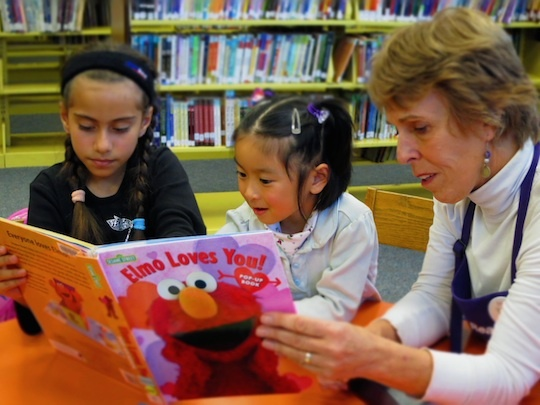 File photo: Lazy summer days can set back children's learning, but reading can help limit their losses, experts say.
