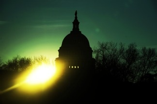 The sun rises over the Captiol Hill in Washington, D.C., on Feb. 1, 2010. As Republicans get ready to take control of the US House of Representatives in about a month, the GOP transition team is thinking up ways the House can save money.