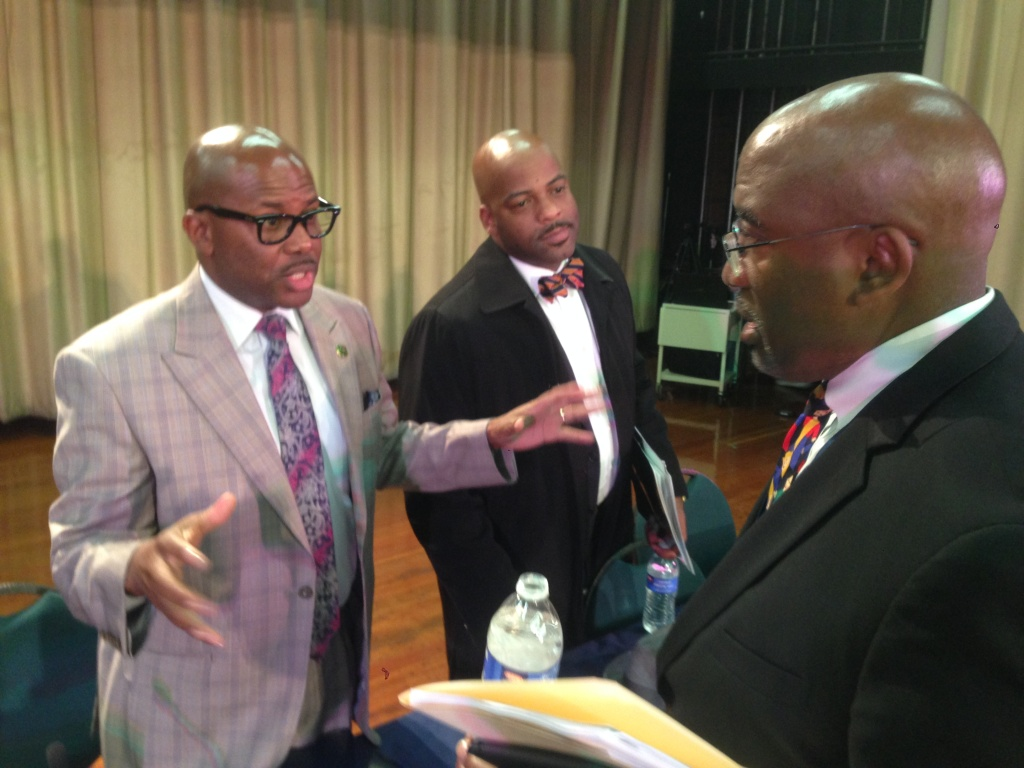 State Assemblyman Mike Gipson, left, and State Senator Isadore Hall, center, talk to Inglewood Unified state administrator Vince Matthews.