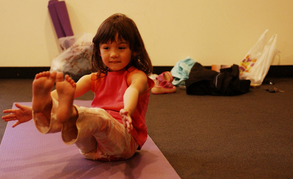 A child poses during Yoga Education for Kids class in Santa Monica, California. In January, Encinitas School District will introduce the most comprehensive yoga program in public schools.