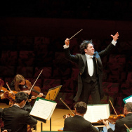 File: Conductor Gustavo Dudamel conducts the Los Angeles Philharmonic. Classical music may help students cram for finals, according to researchers.