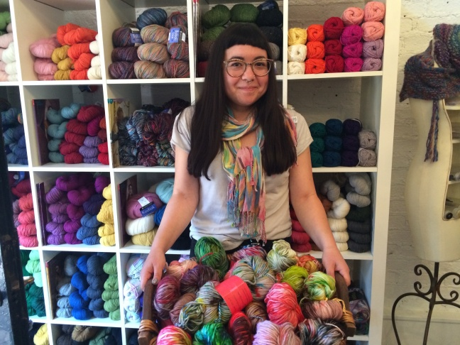 J.R. Jaffe holds a basket of yarns she hand-dyed to sell at Abuelita's