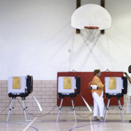 An official assists a voter at a polling station inside Fort Garrison Elementary School in Pikesville, Md., on primary day, June 24. As in many states this primary election season, turnout was low in Maryland.