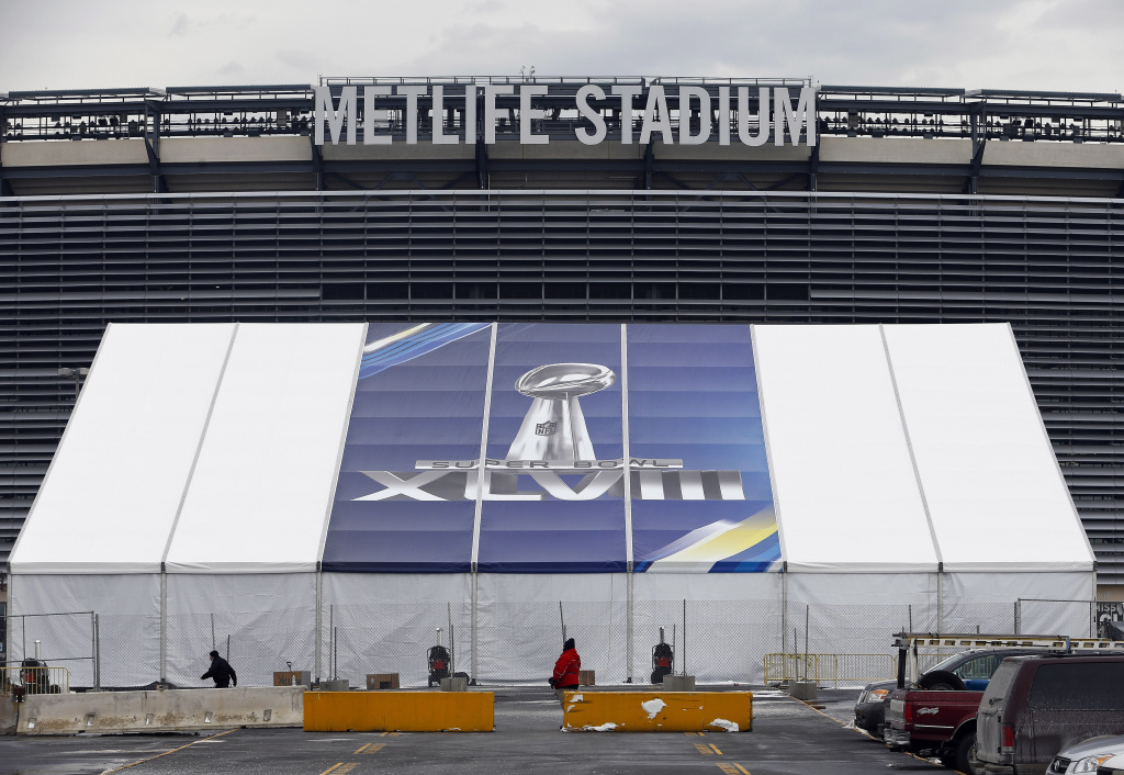MetLife Stadium stands behind a Super Bowl sign as the venue is prepared to host Super Bowl XLVIII between the Denver Broncos and the Seattle Seahawks January 27, 2014 in East Rutherford, New Jersey.