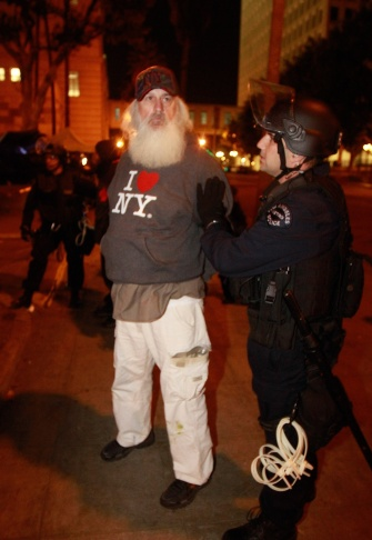 LAPD officers arrested an Occupy Los Angeles demonstrator who had planned to act as a medic.