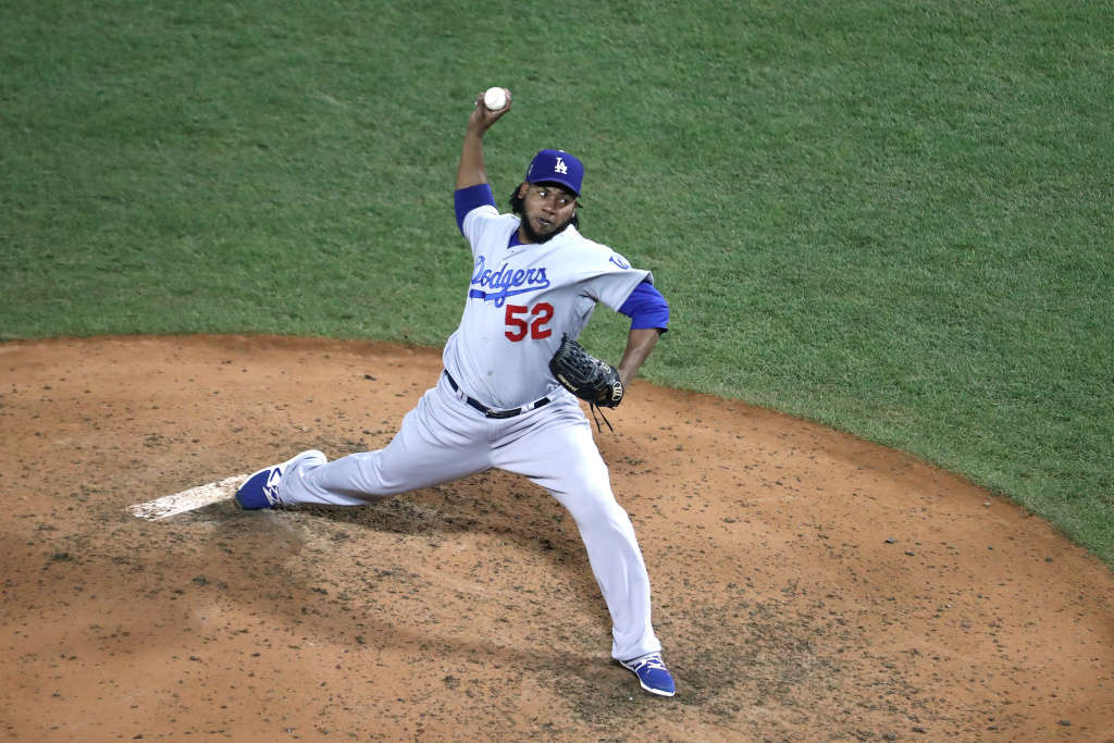Pedro Baez #52 of the Los Angeles Dodgers throws a pitch against the Boston Red Sox in the eighth inning in Game Two of the 2018 World Series at Fenway Park on October 24, 2018 in Boston, Massachusetts.