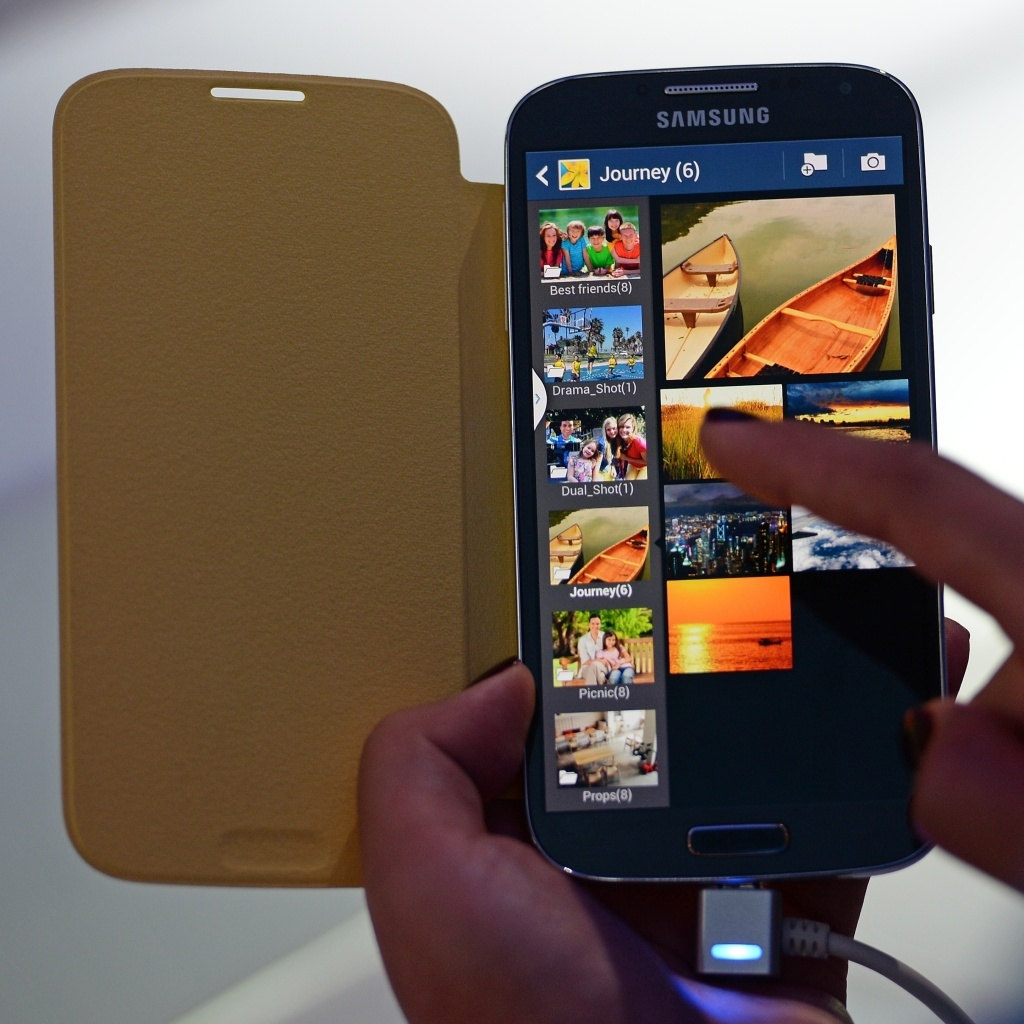 The Samsung Galaxy S4 smartphone. Studies show that today's teens regularly use more than one screen at a time to stay connected.