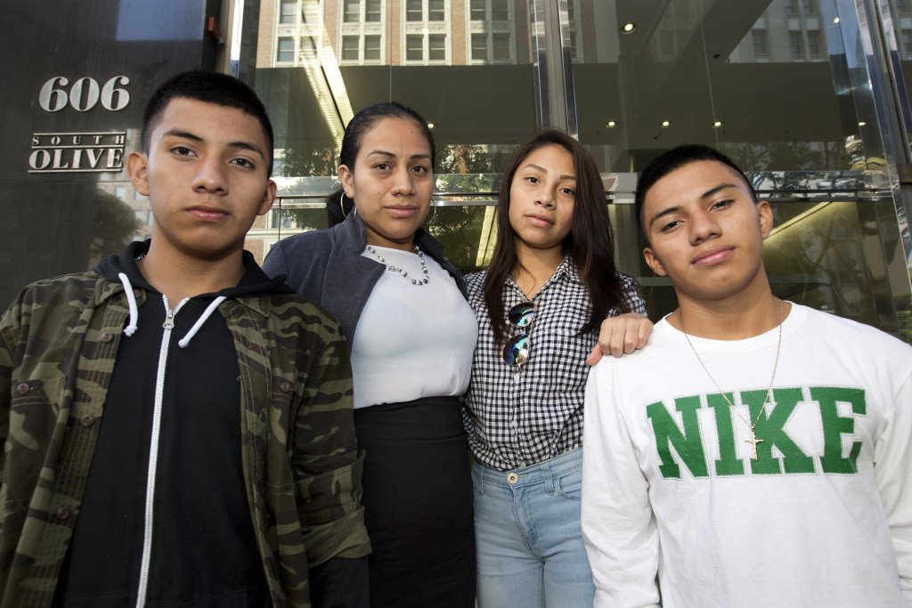 Left to right: Luis González (16), his mother Ana Hernández, sister Mariela Michell Beltrán-Hernandez (15)  and brother Alejandro González (16), stand on the steps of L.A.'s immigration court in downtown just ahead of a court date for their younger sister on Friday August 12th, 2016. Mariela arrived in the U.S. in March 2016 to reunite with her older brothers and mother after years of separation. She now faces an immigration judge to fight her deportation from the U.S. She is seeking asylum to remain in the U.S. She said she fled gang violence in her home country of El Salvador.