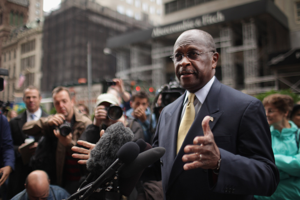 Republican presidential candidate Herman Cain speaks to the media outside of Trump Towers.