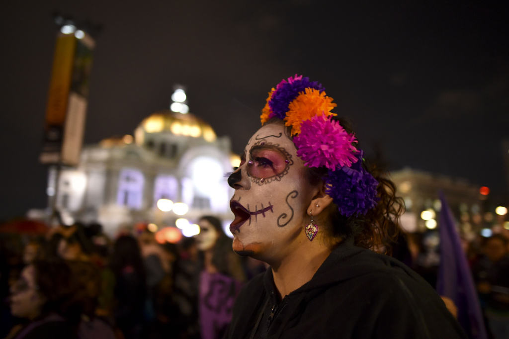 A woman shouts slogans during a protest against femicides in Mexico City on November 1, 2016.