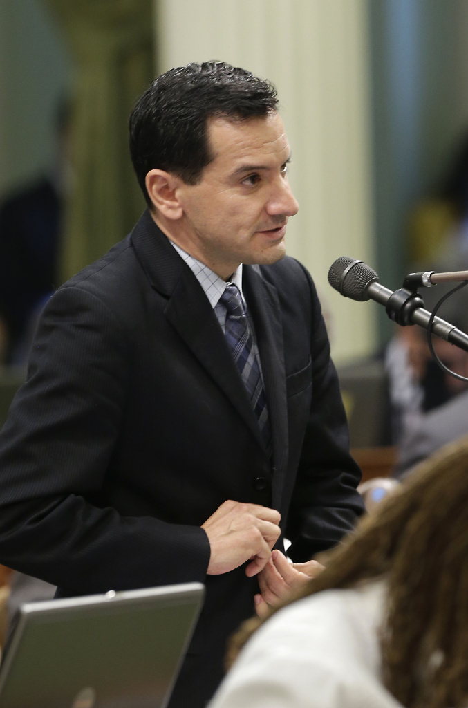 Assemblyman Anthony Rendon, D-Lakewood, urged lawmakers to approve his measure that would ban hunters from using lead ammunition, during Assembly session  in Sacramento, Calif., Tuesday, Sept. 10, 2013.  The Assembly passed Rendon's bill,  AB711. (AP Photo/Rich Pedroncelli)