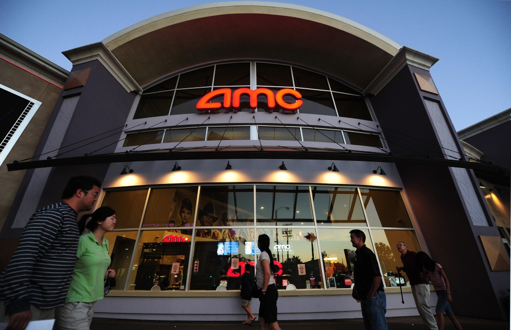 People walk past movie theaters of the US cinema chain AMC Entertainment in Monterey Park, east of downtown Los Angeles on May 22, 2012 in California.