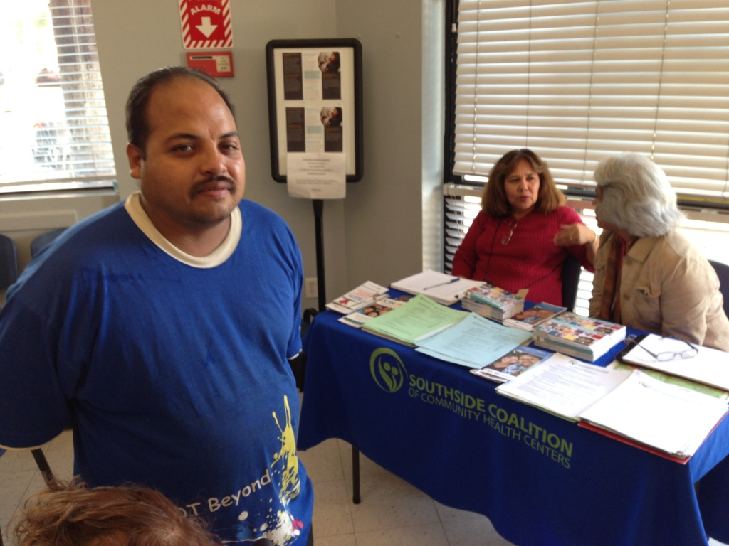 Jorge Ramirez, uninsured, healthy and 33, ponders his options under Covered California at the South Central Family Health Center in south L.A. The state-run health insurance marketplace acknowledges that it needs to sign up many more Latinos.