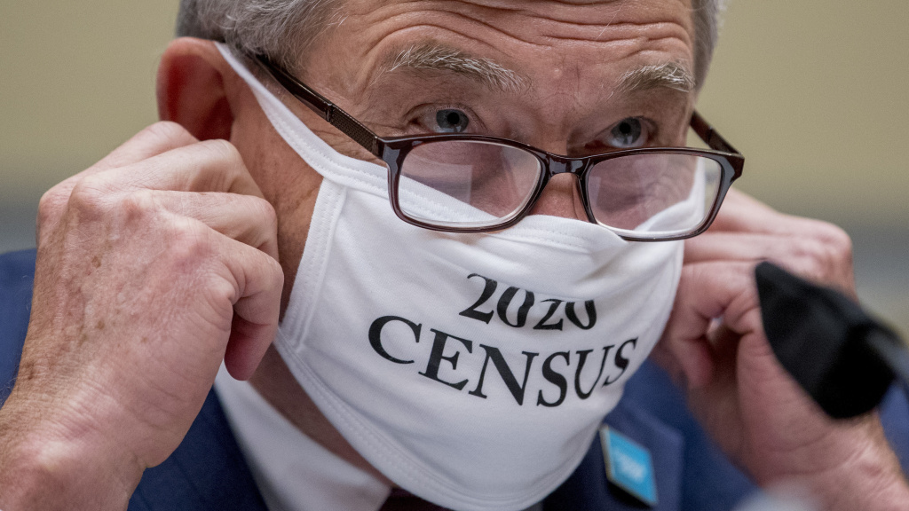 Census Bureau Director Steven Dillingham, wearing a face covering printed with the words