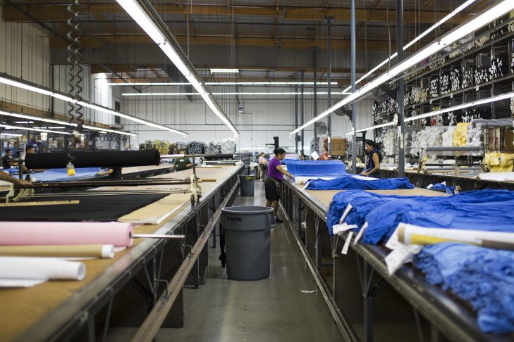 Caroline Tiznado works in the finishing and detailing department at Karen Kane's clothing manufacturing facility in Vernon on Friday June 26, 2015.