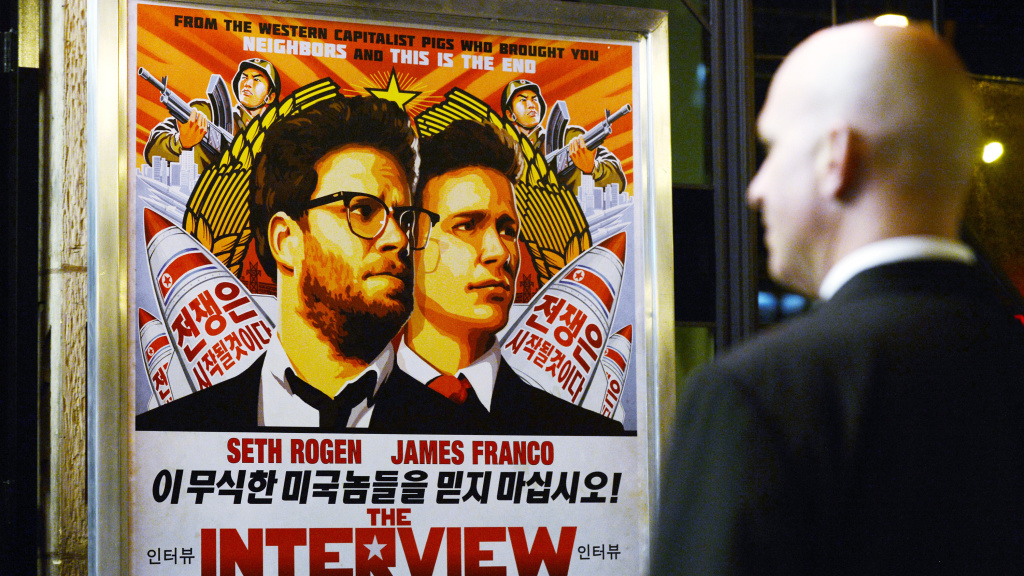 U.S. intelligence officials believe North Korea was centrally involved in the recent attack on Sony Pictures' computer network — possibly out of retribution for its film <em>The Interview</em>. Above, a security guard stands outside a theater during the film's premiere in Los Angeles last week.