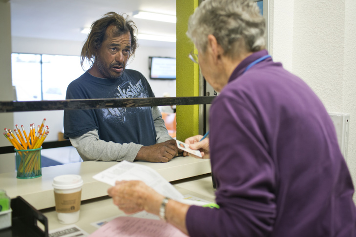 Tony Uribe turns in paperwork to get financial assistance at Share our Selves in Costa Mesa on Friday morning, May 29, 2015. Financial assistance is one of many homeless support services that require an identification card.