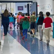 Students walking the hallways are seen February 21, 2014, at Steuart W. Weller Elementary School in Ashburn, Virginia.