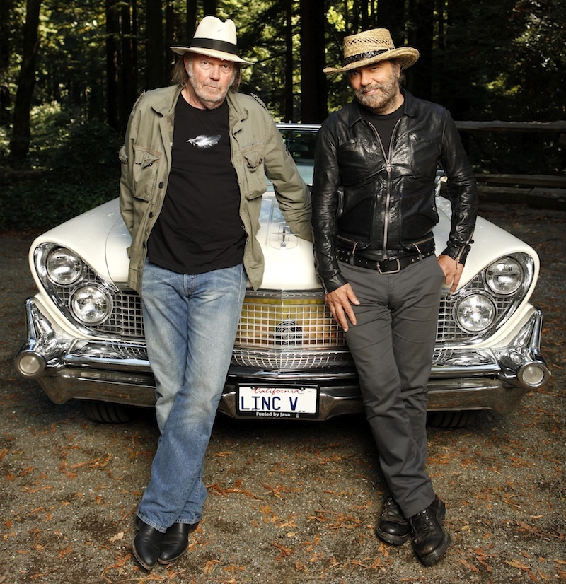 Musicians Neil Young and Daniel Lanois are photographed beside Young's 1959 hybrid Lincoln Continental in Woodside, CA.