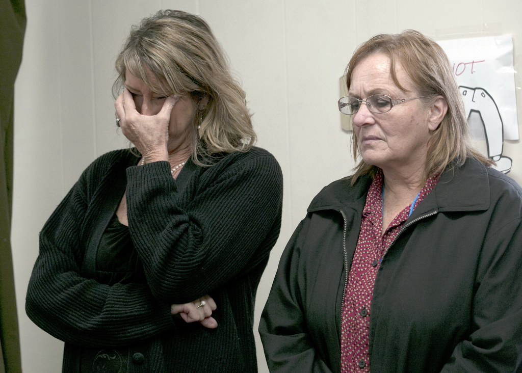 Lynda Patton, left, and Shawnee Flournoy, employees of the Corning Union Elementary School District, react as district superintendent, Rick Fitzpatrick, discusses the shooting rampage by Kevin Janson Neal, during a news conference Wednesday, Nov. 15, 2017, in Corning, Calif. Neal went on a shooting spree, Tuesday, which included an attack on the Rancho Tehama Elementary School, where one student was injured. Neal killed five people, including his wife, before being shot and killed by Tehama County Sheriff's deputies. Fitzpatrick cited quick action by teachers and employees for locking down the school which prevented Neal from entering any of the classrooms.