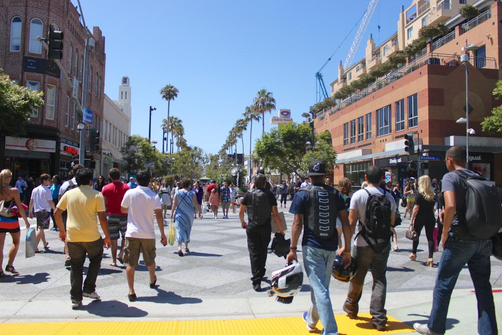 Pedestrians walk toward the Third Street Promenade in downtown Santa Monica.