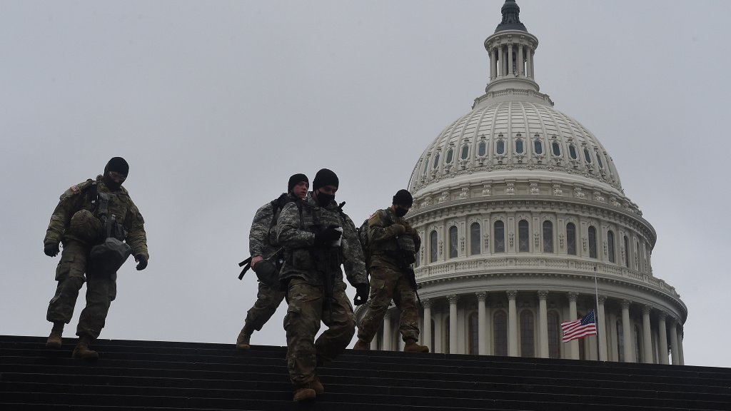 Members of the National Guard walk past the U.S. Capitol during the second impeachment trial of former President Donald Trump on Thursday.