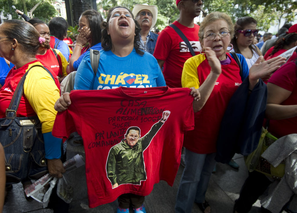 Supporters of Venezuela's President Hugo Chavez rally in Caracas on December 9, 2012. Chavez admitted a relapse of his cancer late Saturday and designated vice president Nicolas Maduro as his heir apparent in case 'something happened' to him.