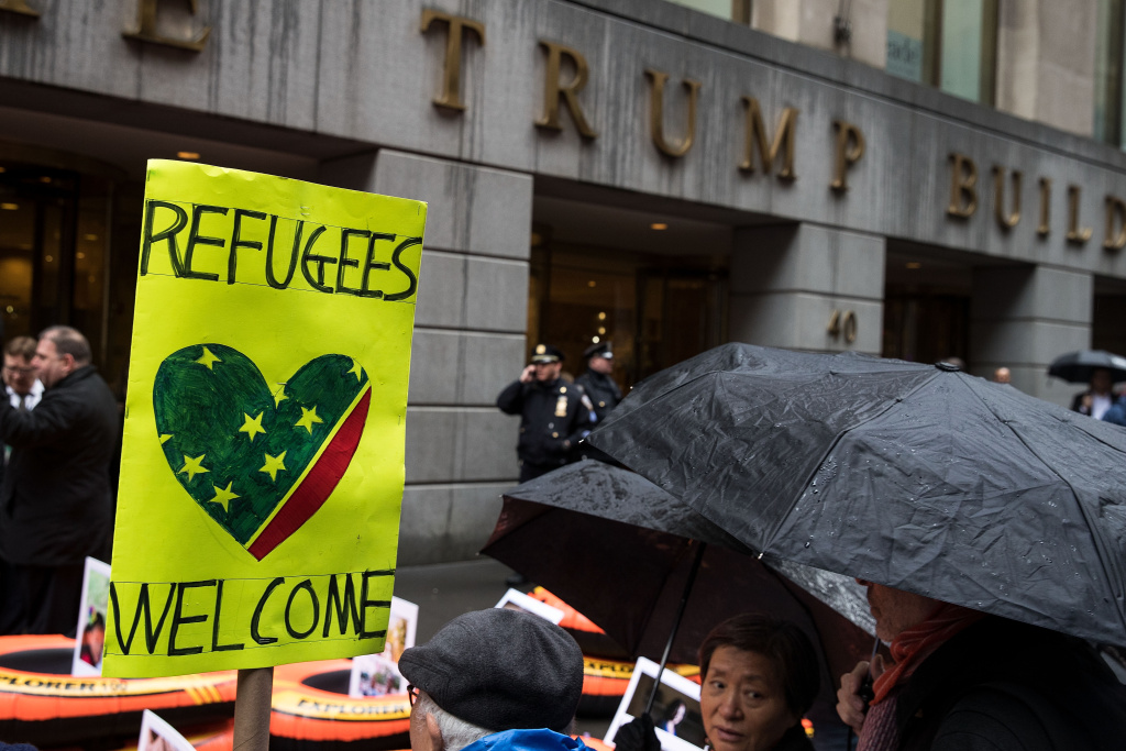 Protestors rally in front of the Trump Building on Wall Street during a protest against the Trump administration's proposed travel ban and refugee policies, March 28, 2017 in New York City. The Trump administration's proposed travel ban includes a provision that would bar refugees entry into the United States for 120 days.