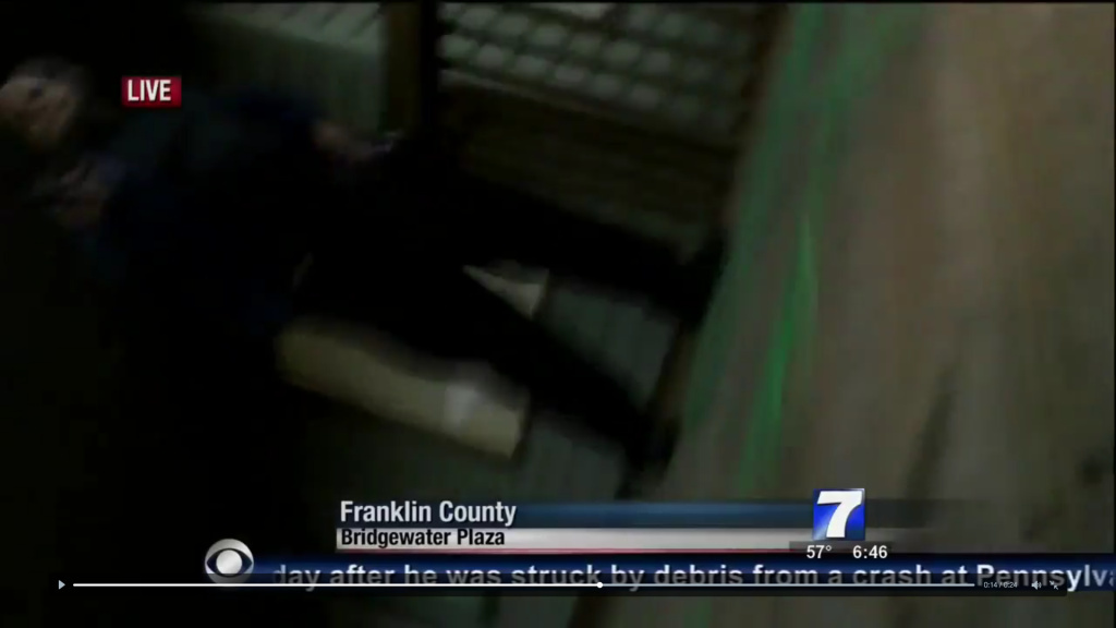 A figure, possibly the suspect, is shown during a live news broadcast from Virginia station WDBJ7 as shots are fired on Wednesday, August 26, 2015. The reporter and photographer were killed.