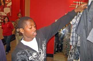 Khalfani Jones, 16, shopping at Target using a gift card from the Salvation Army
