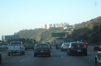 FILE: Commuters travel south on the San Diego 405 Freeway through the Sepulveda Pass. Constructing a tunnel with a toll road or light rail line under this stretch of highway could be one proposal funded by a potential sales tax increase Metro wants to put on the November ballot.