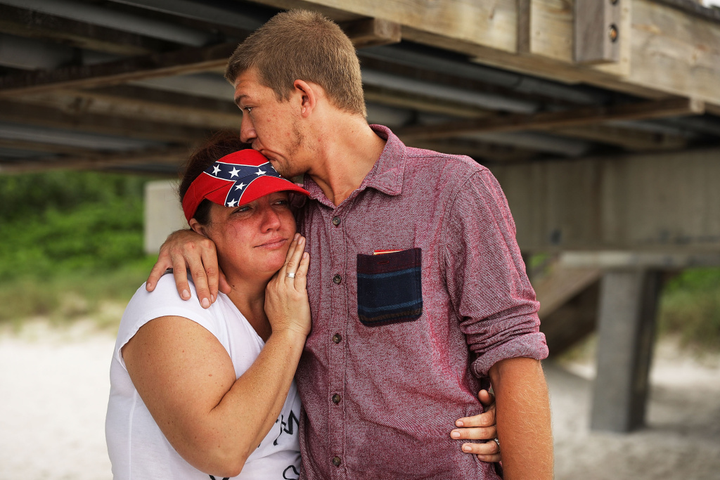 Jordan Alvarez hugs his mother Katie as they stand on the beach in Naples, Florida before the arrival of Hurricane Irma on September 9, 2017.