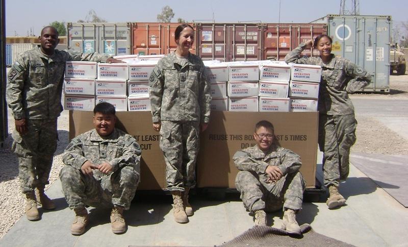 Troops help prepare packages for troops overseas during Operation Gratitude.