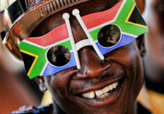 A South African welcomes the Chilean national football team's arrival Sunday.