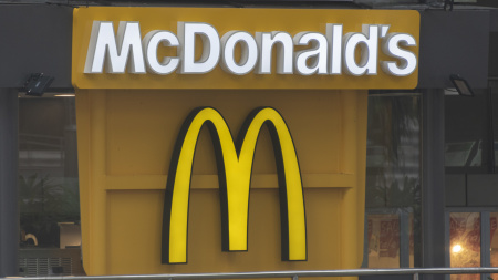 The McDonald's logo appears on the side of a McDonald's location.