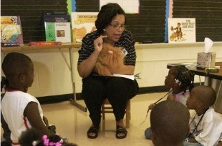 Jocelyn Mouton, Executive Principal helps teach a kindergarten class.