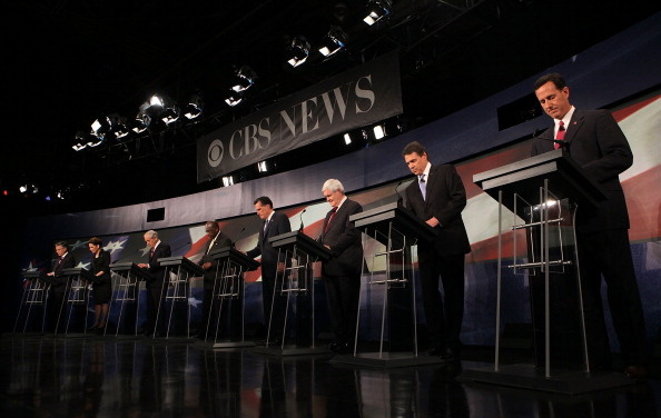 Republican presidential candidates (L-R) former Utah Governor Jon Huntsman, Rep. Michele Bachmann (R-MN), Rep. Ron Paul (R-TX), businessman Herman Cain, former Massachusetts Governor Mitt Romney, former Speaker of the House Newt Gingrich (R-GA), Texas Governor Rick Perry, and former Sen. Rick Santorum (R-PA) get ready prior to a presidential debate at Wofford College Nov. 12, 2011, in Spartanburg, South Carolina. The debate was focused on national security and foreign policy.