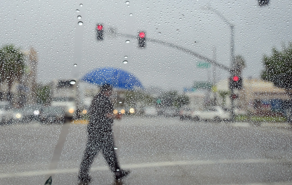 File: A man crosses a street during a steady rainfall on Sept. 15, 2015 in L.A., as a low-pressure system filled with moisture from a former tropical cyclone unleashed heavy rain.