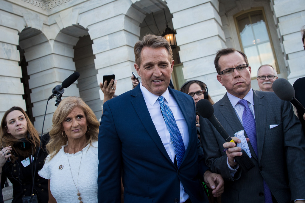 Sen. Jeff Flake (R-AZ) and his wife Cheryl Flake leave the U.S. Capitol as they are trailed by reporters, October 24, 2017 in Washington, DC. Flake announced that he will not be seeking re-election and he will leave the Senate after his term ends in 14 months.