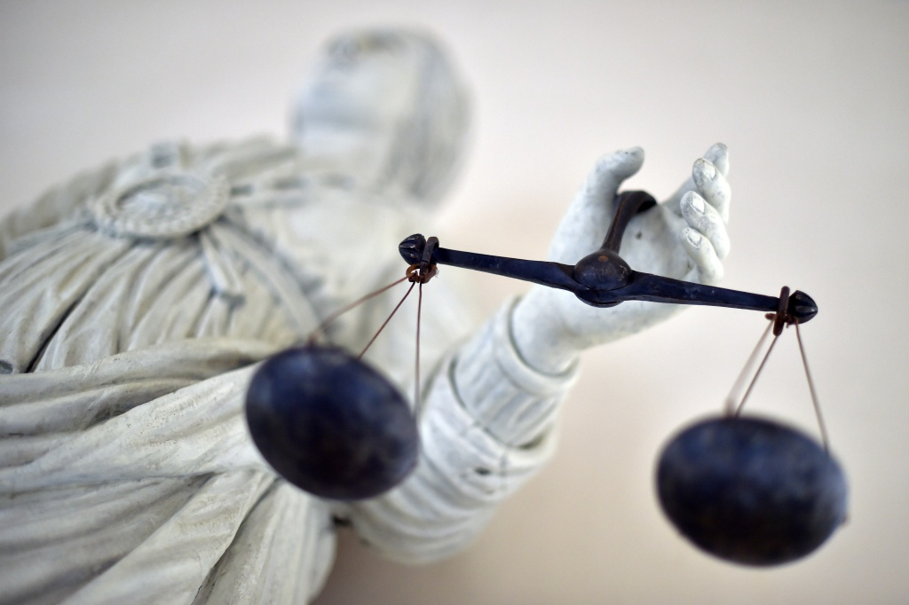 A picture taken at a courthouse in Rennes, France shows a statue of the goddess of hustice balancing the scales.
