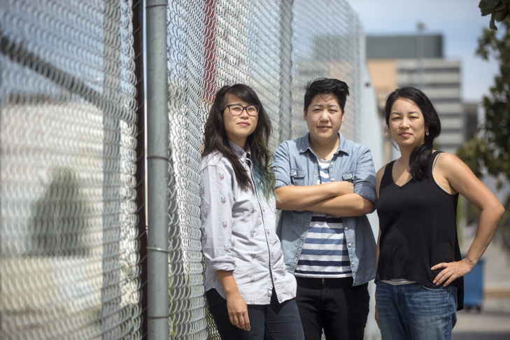 Protect Koreatown organizers TK Lê, left, Audrey Kuo and Lisa Fu stand outside an empty lot – the site of a 27-story residential development in Koreatown on South Catalina Street.