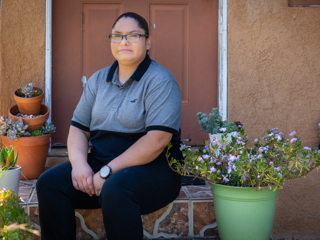 Carmen Quintero works as a supervisor at a distribution center for N95 masks. She owes $1,840 for other care she received when she tried to get a test for COVID-19.