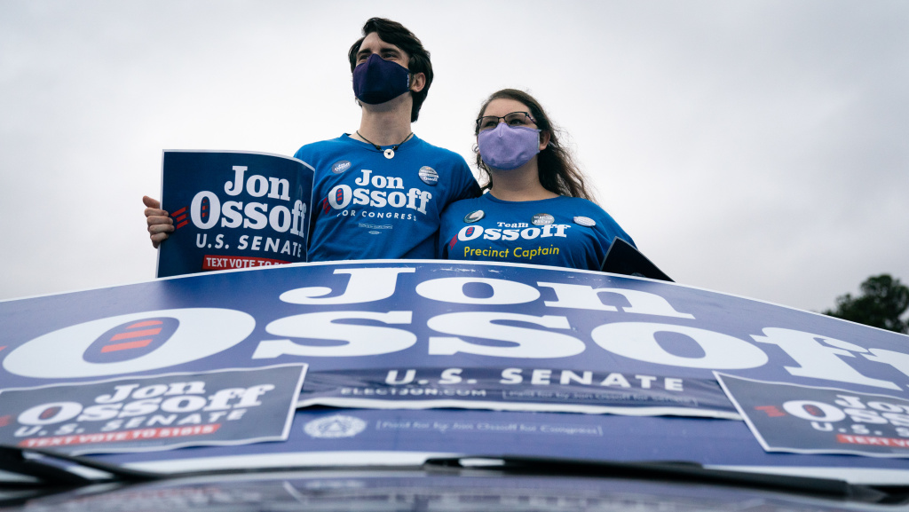 Supporters wait to hear Democratic U.S. Senate candidate Jon Ossoff speak at a drive-in campaign event on Tuesday in Atlanta. Ossoff's challenge to incumbent Sen. David Perdue has gone to a runoff that will be decided in January.