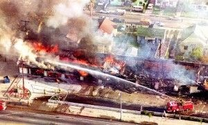 A fire department crew sprays water on a burning mini-mall in South Los Angeles, April 30, 1992