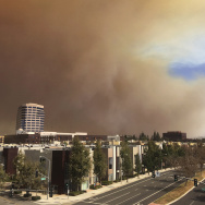 A large plume of smoke from a brush fire rises over the city of Orange, Calif., on Monday, Oct. 9, 2017. A wildfire has erupted about 45 miles southeast of Los Angeles in the hill country of eastern Orange County. The Anaheim Fire Department said the fire erupted late Monday morning.