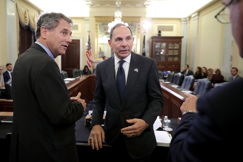 Sen. Sherrod Brown (D-OH) (L) and Veterans Affairs Secretary Robert McDonald visit before a hearing of the Senate Veterans' Affairs Committee in the Russell Senate Office Building on Capitol Hill September 14, 2016 in Washington, DC. The VA leaders testifies about the future of the VA following the publication of the Commission on Care Report.