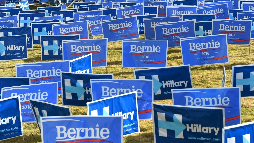 Bernie Sanders and Hillary Clinton signs are display. Will you be voting today?