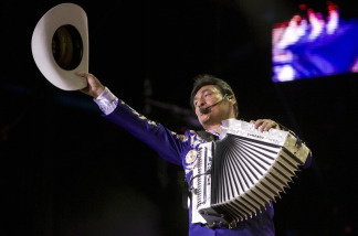 Jorge Hernandez singer and lead of Mexican band Los Tigres del Norte, sings during the ALAS concert at the Zocalo Square in Mexico City, on May 17, 2008.