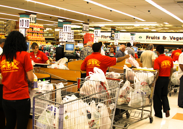Super King employees bag loads of groceries in Glassell Park.