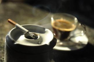 A cigarette burns in a bar near Madrid, Spain.